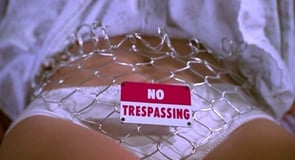 Photo of woman wearing no trespassing sign on underwear