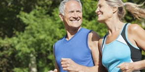 Photo of senior couple running