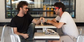 Photo of gay men meeting at coffee shop
