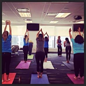 Photo of POF team doing yoga