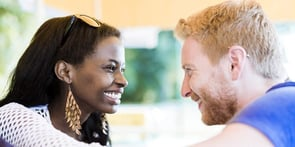 Photo of man and woman making eye contact