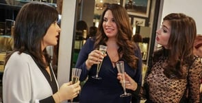 Photo of Maria Avgitidis talking with two other women