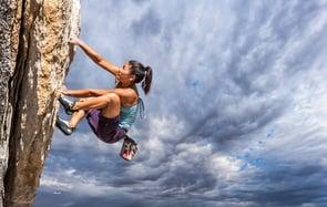 Photo of a girl rock climbing