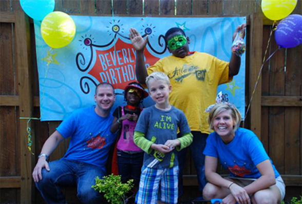 Photo of volunteers at a birthday party for homeless children