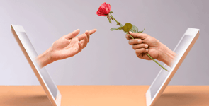 Photo of someone handing out a rose from a tablet screen