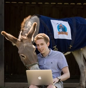 Picture of Jack Cator, Founder of Hide My Ass!, and a donkey