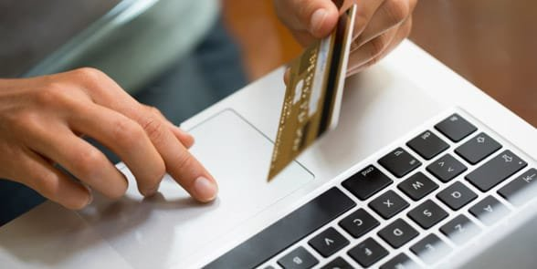Photo of someone paying for something online