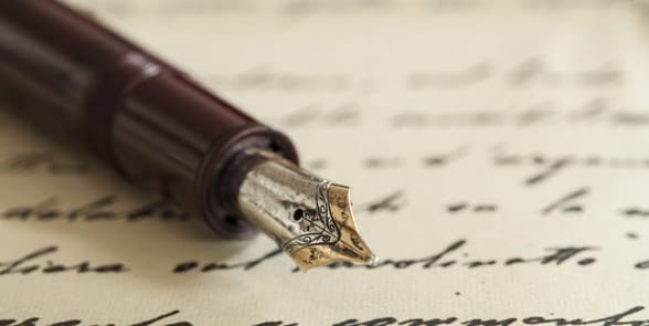 Photo of a pen and written poem