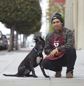 An SF SPCA volunteer with a dog