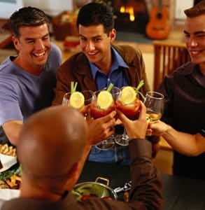 Photo of men toasting at a dinner