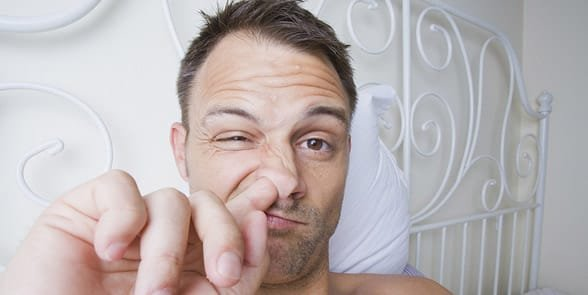 Photo of a man picking his nose
