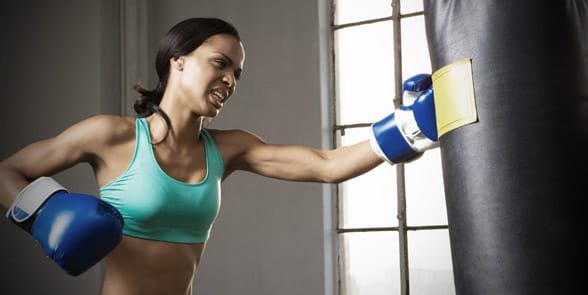 Photo of a woman boxing