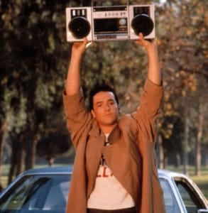 Photo of John Cusack standing with a boombox