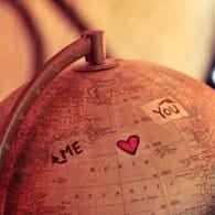 Photo of a globe with a heart