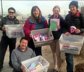 Photo of AFSC members delivering Valentine's Day cards