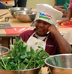 Photo of a boy taking part in the Kids Cook Monday campaign