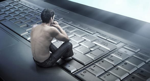 Photo of a man lovingly staring at a computer