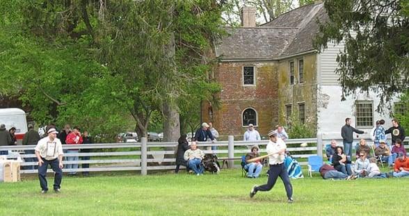 Photo of a vintage baseball game at Spenser-Pierce-Little Farm