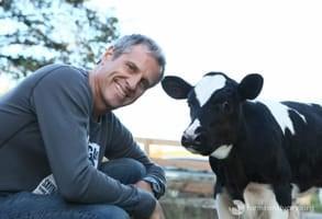 Photo of Gene with a calf named Ari