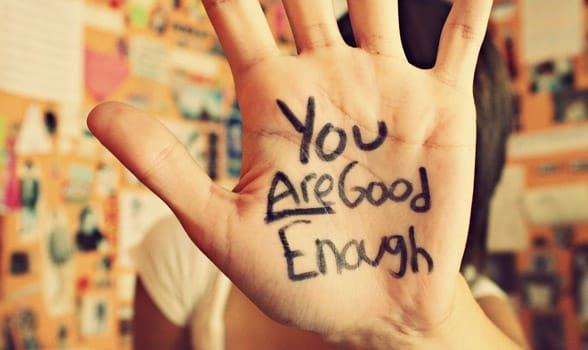 Photo of You Are Good Enough written on someone's hand