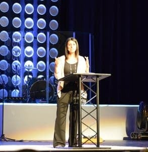 Photo of blogger Debra Fileta on stage at a speaking event