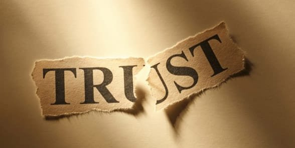 Photo of trust written on paper and ripped