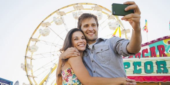 Photo of a couple on a date at a fair