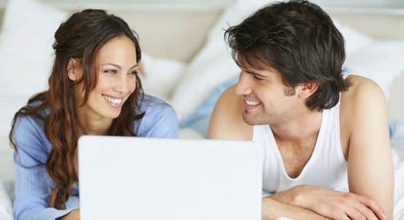 Photo of a couple on a laptop