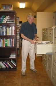 Photo of Stephen Barrett at a file cabinet