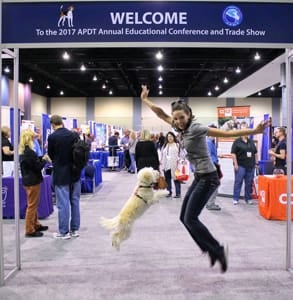 Photo of a dog owner and her dog at the APDT's conference