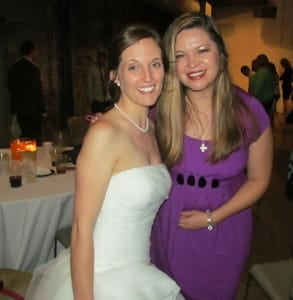 Photo of Anna with a bride who met her husband while speed dating