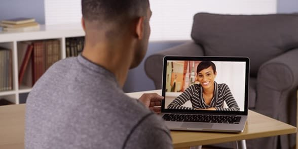 Photo of a couple Skyping