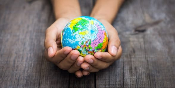 Photo of someone holding a small globe