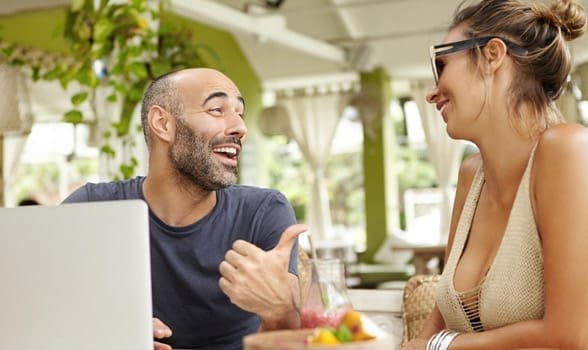 Photo of a man laughing at a woman