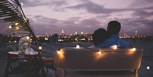 Photo of a couple on a rooftop date
