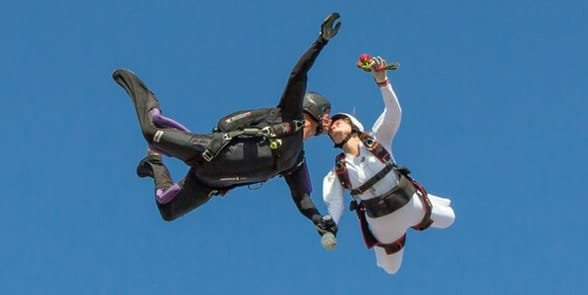 Photo of a couple skydiving