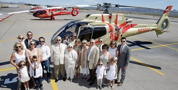 Photo of the Halvorson family in front of a Papillon helicopter