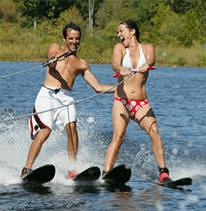 Photo of a couple water skiing at Club Getaway