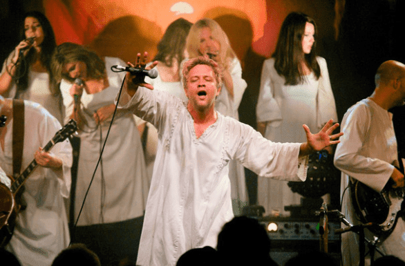 Photo of Tim DeLaughter on stage with The Polyphonic Spree