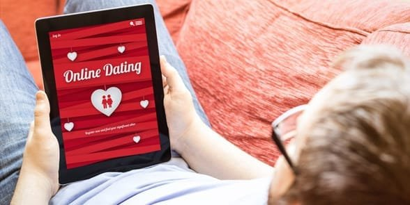 Photo of a man looking at a dating site