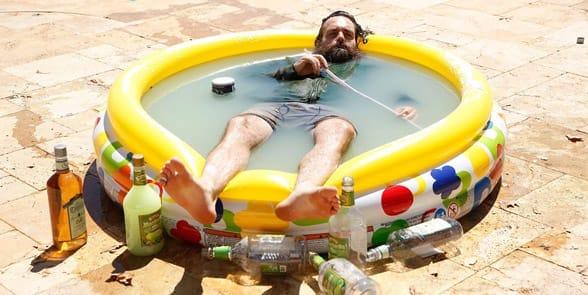 Photo of a man in a kiddie pool