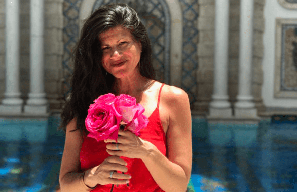 Photo of Carin Rockind and flowers