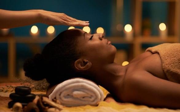 Photo of woman receiving Reiki treatment