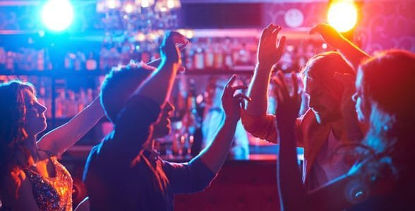 Photo of people dancing at a club