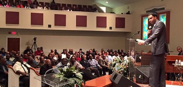 Photo of Dr. Tartt speaking at a church