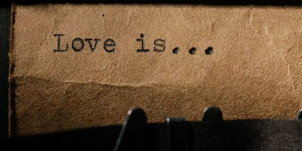 Photo of a typewriter with love is on it