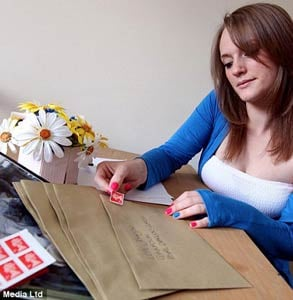 Photo of Jen Johnson sending a letter to her husband in the military