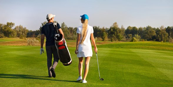 Photo of a couple playing golf