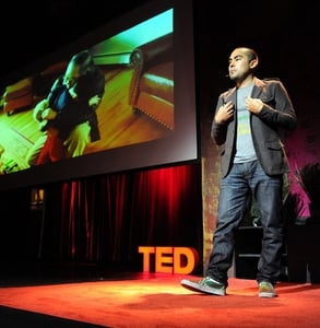 Photo of Cesar giving a TED talk