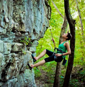 Photo of a woman rockclimbing at Monte Sano Park